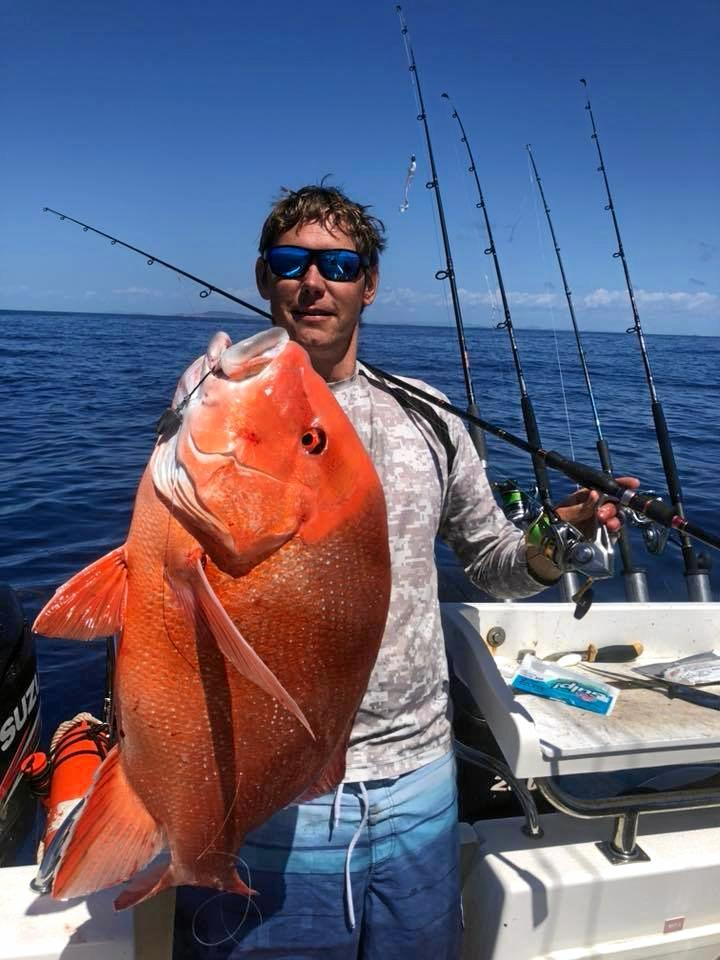 Tim Price, Double Threat Charters, with a whopper red emperor he reeled in.