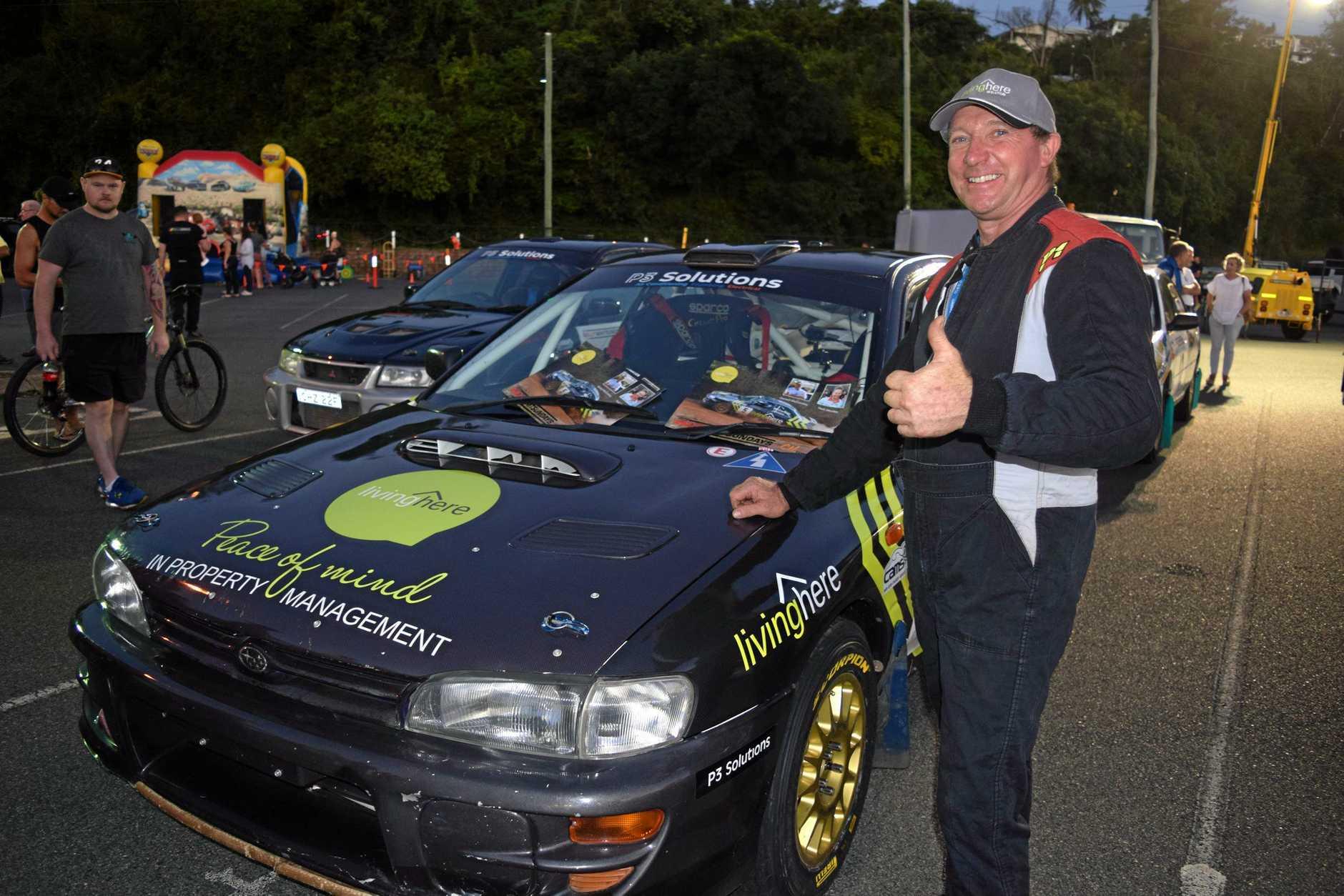 Rally competitor Brisbane's Gerard McConkey shows off his 1999 Subaru WRX during last Friday night's festivities.