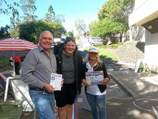 Blair Federal candidate John 'Sandy' Turner with voters at pre-poll.