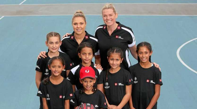 AWARDS OPEN: 2018 Australia Post One Netball ambassadors Caitlin Thwaites and Kate Moloney with players from the Itiki Sporting Club.