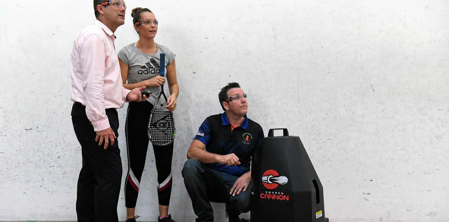 BIT HIT: Bundaberg MP  David Batt, Tasmin Swan  and Brendan Egan check  out the squash cannon.
