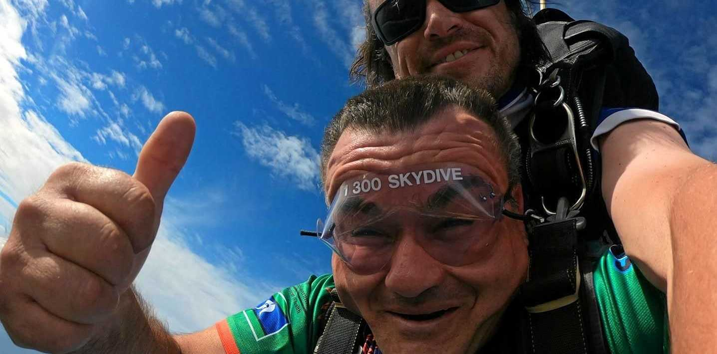 TRIBUTE: Brett Parkhurst skydived last month in honour of his partner Catherine (inset) who died of breast cancer and left behind daughter, Montana (inset).