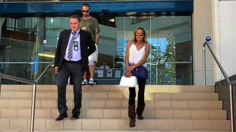 Detective Acting Inspector Paul Elliott, who was involved in investigating Lattrell Dodd's death, leaves court with the only motherly figure the 12-week-old infant knew in his short life, Tanya Dodd.