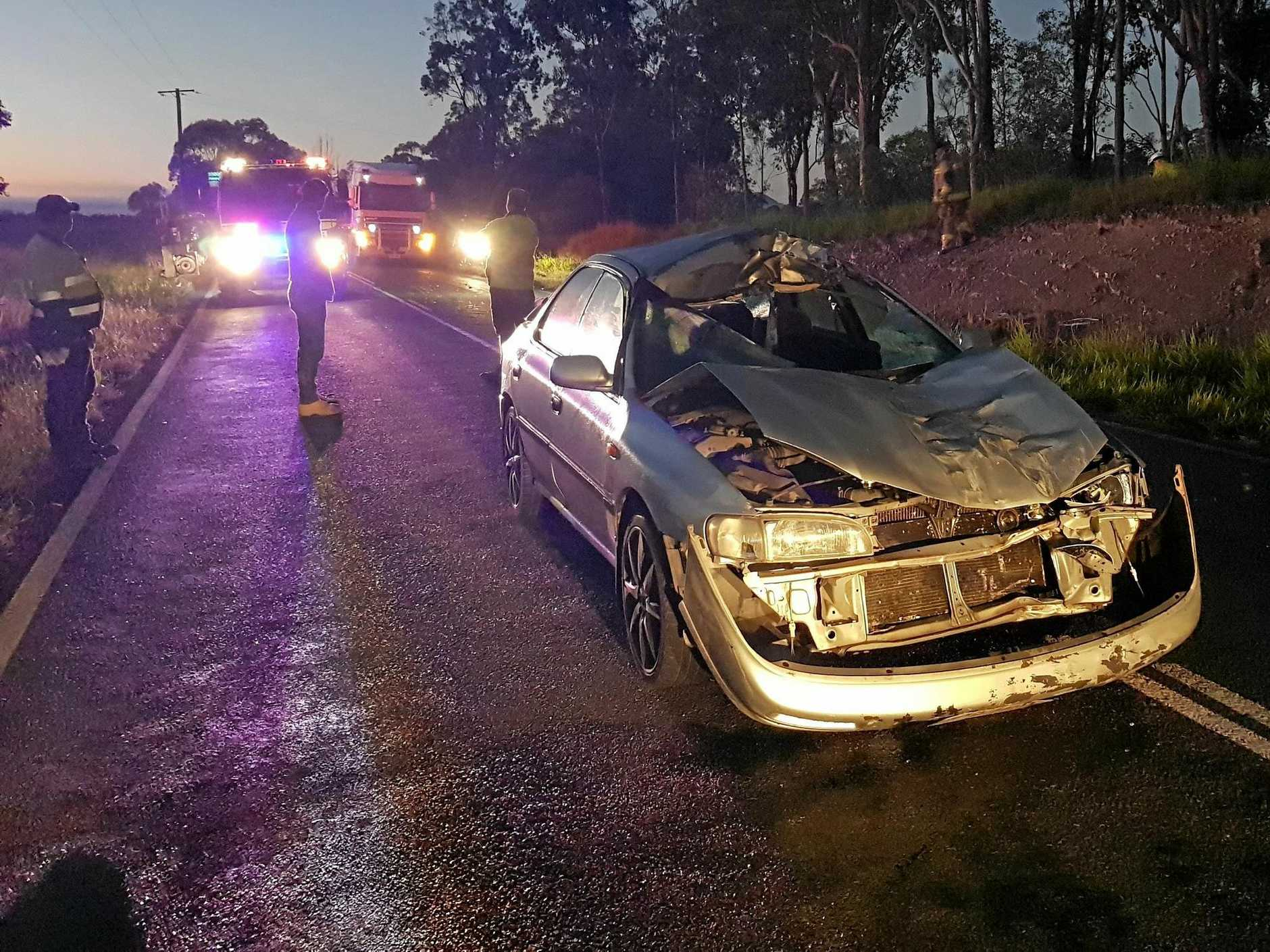 CRUSHED: Imbil police report a driver's lucky escape when he hit a 700kg bull, which rolled onto his car and crushed it around him.