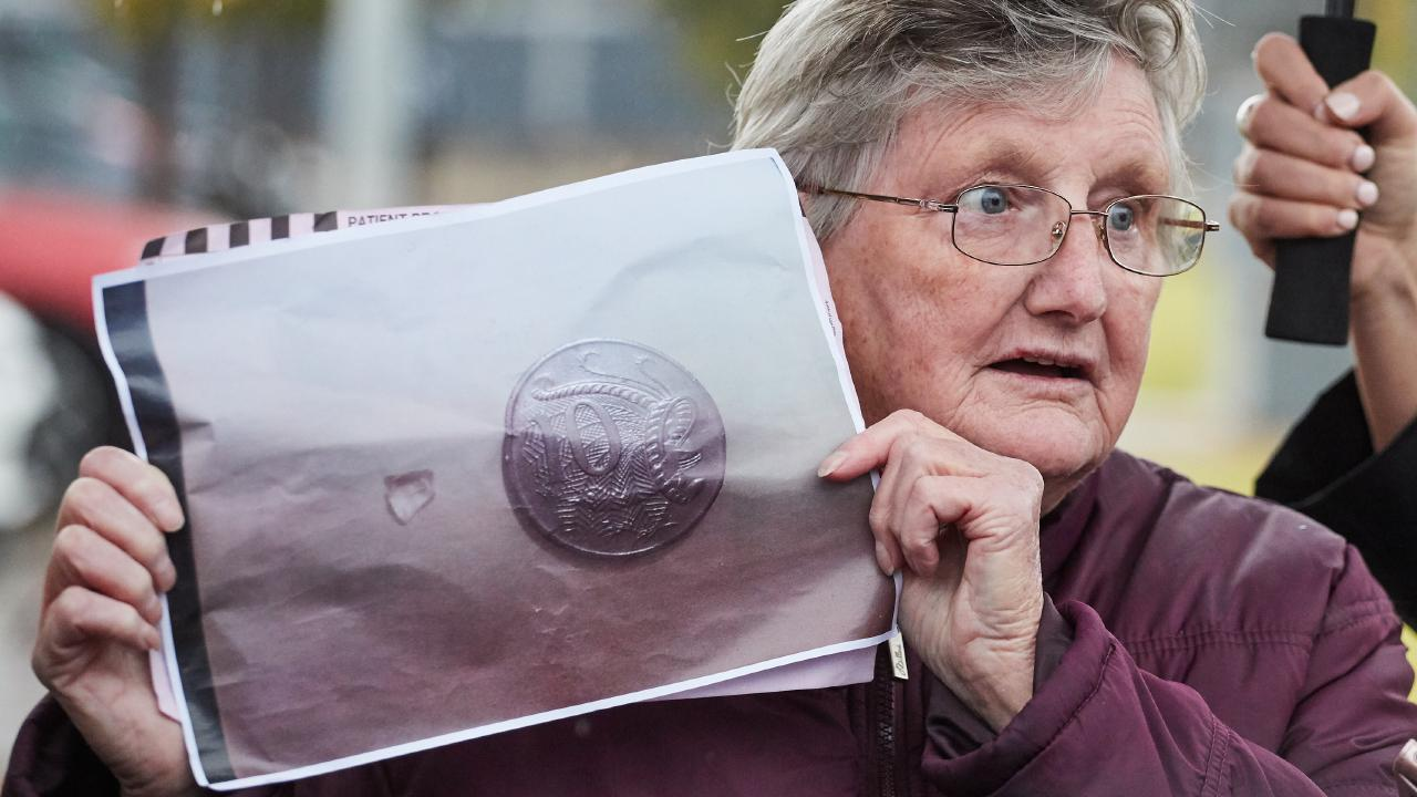 Munno Para resident, Patricia Smith, 73 outside the Lyell McEwin Hospital in Elizabeth Vale, with the piece of glass found in her hospital food. Picture: Matt Loxton