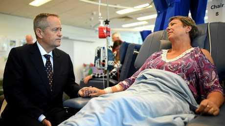Opposition Leader Bill Shorten speaks to cancer patient Judy Dixon at a Brisbane hospital. Picture: Lukas Coch