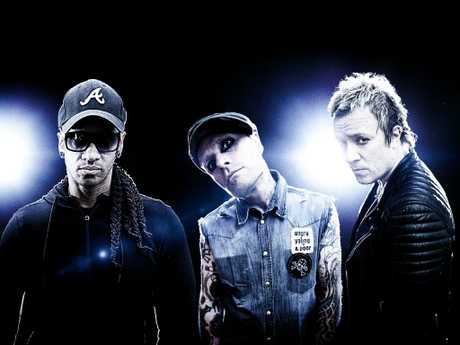 """Liam Howlett (far right) said he was """"heartbroken"""" by longtime friend and bandmate Keith Flint's death. Picture: Supplied"""