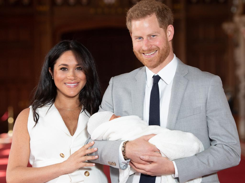 Prince Harry, Duke of Sussex and Meghan, Duchess of Sussex, with their newborn son in St George's Hall at Windsor Castle on May 8, 2019 in Windsor, England. Picture: Getty