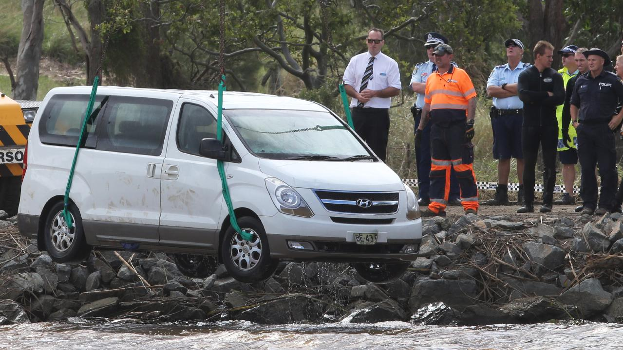 The family's van is lifted out of the river. Picture: Glenn Hampson