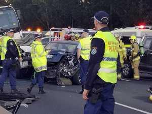 Tradie dead, nine in hospital after horror crash