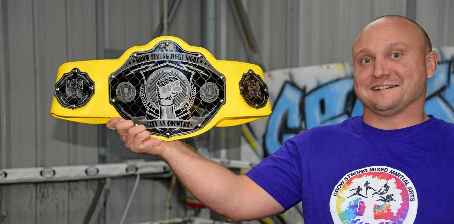 TITLE BELT: Grow Strong Mixed Martial Arts head trainer Ben Pepper with the championship buckle to be decided on Saturday at WIRAC.