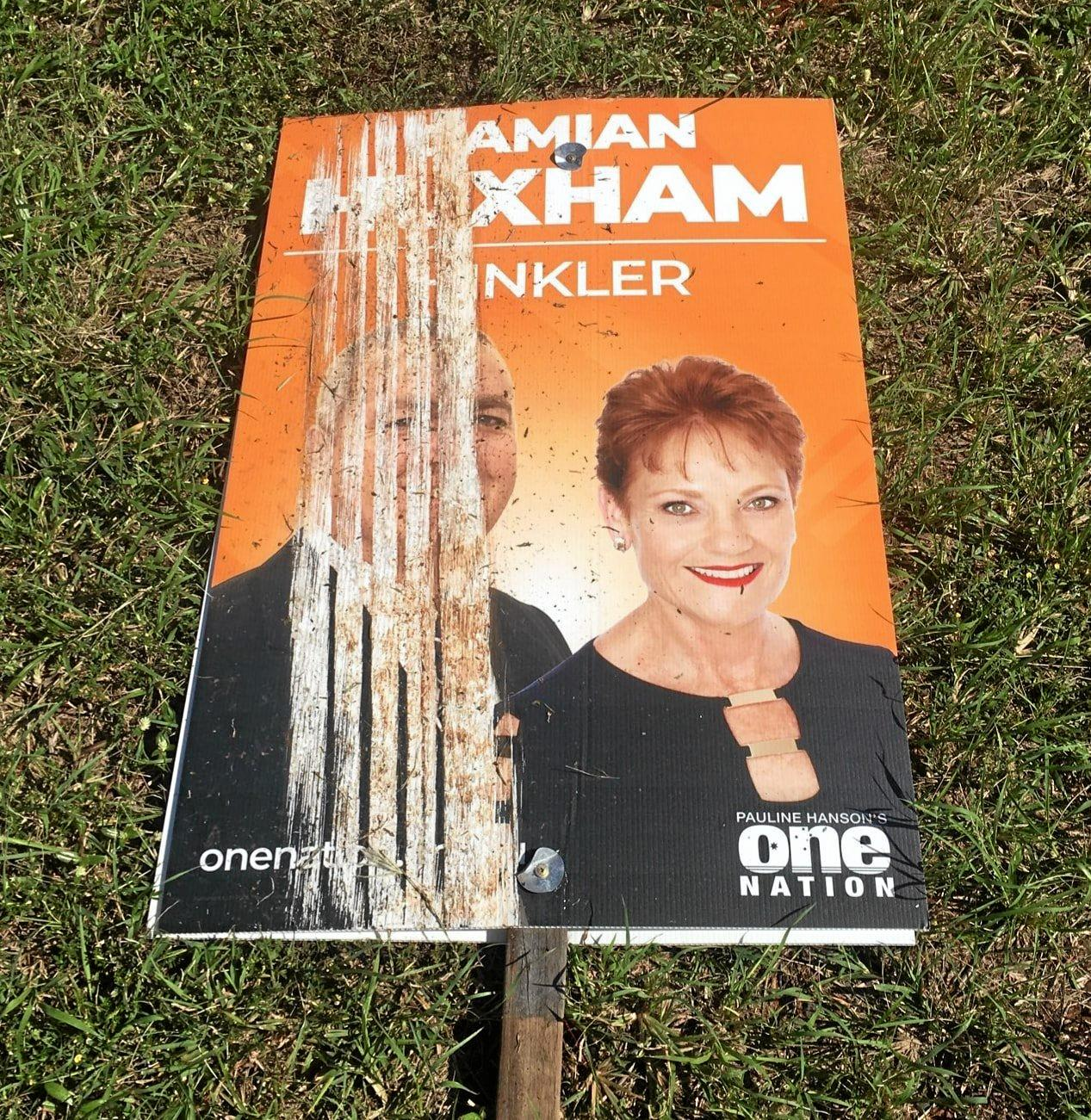 About 40 corflutes belonging to One Nation's Hinkler candidate Damian Huxham have been damaged by vandals.