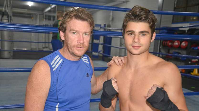 IN FINE FORM: Warwick Boxing Club head trainer Damien Lawler with Jake Wyllie.