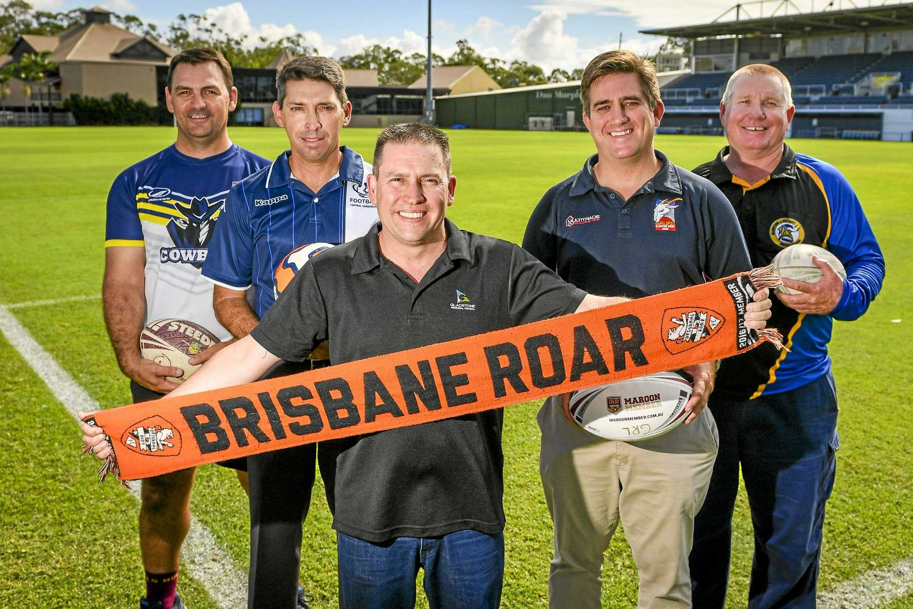 ROARSOME: Michael Cavanagh (NRL Touch Premiership), Andrew Pelling (Football CQ), Gladstone mayor Matt Burnett, Gladstone Rugby Union committee member Anthony Groen-Int-Woud and Gladstone Rugby League president Richard Duff at the announcement of future plans for Marley Brown Oval and that Brisbane Roar will play at the venue in July.