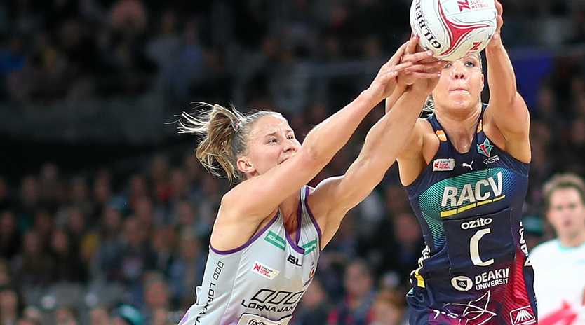 The Firebirds' Mahalia Cassidy and the Vixens' Kate Moloney compete for possession in the opening round clash between their teams. Picture: Scott Barbour/Getty Images