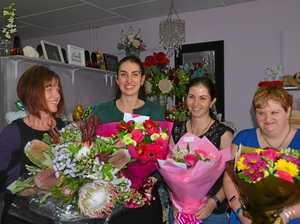 Chain of workers bands together so you can give mum flowers