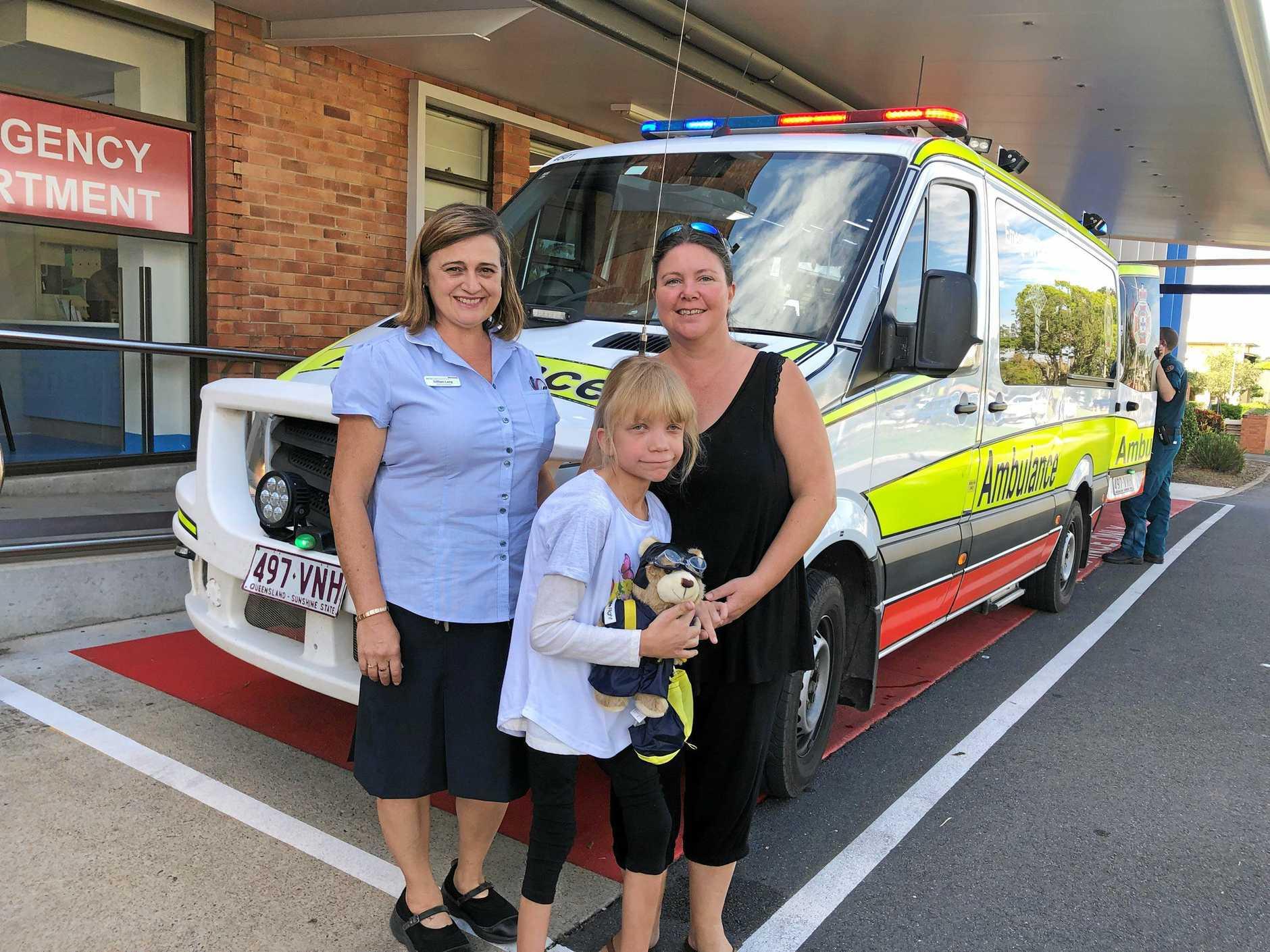 Paediatric nurse navigator Gillian Lang with Amber Hewson, 7, and Sabrina Spice.