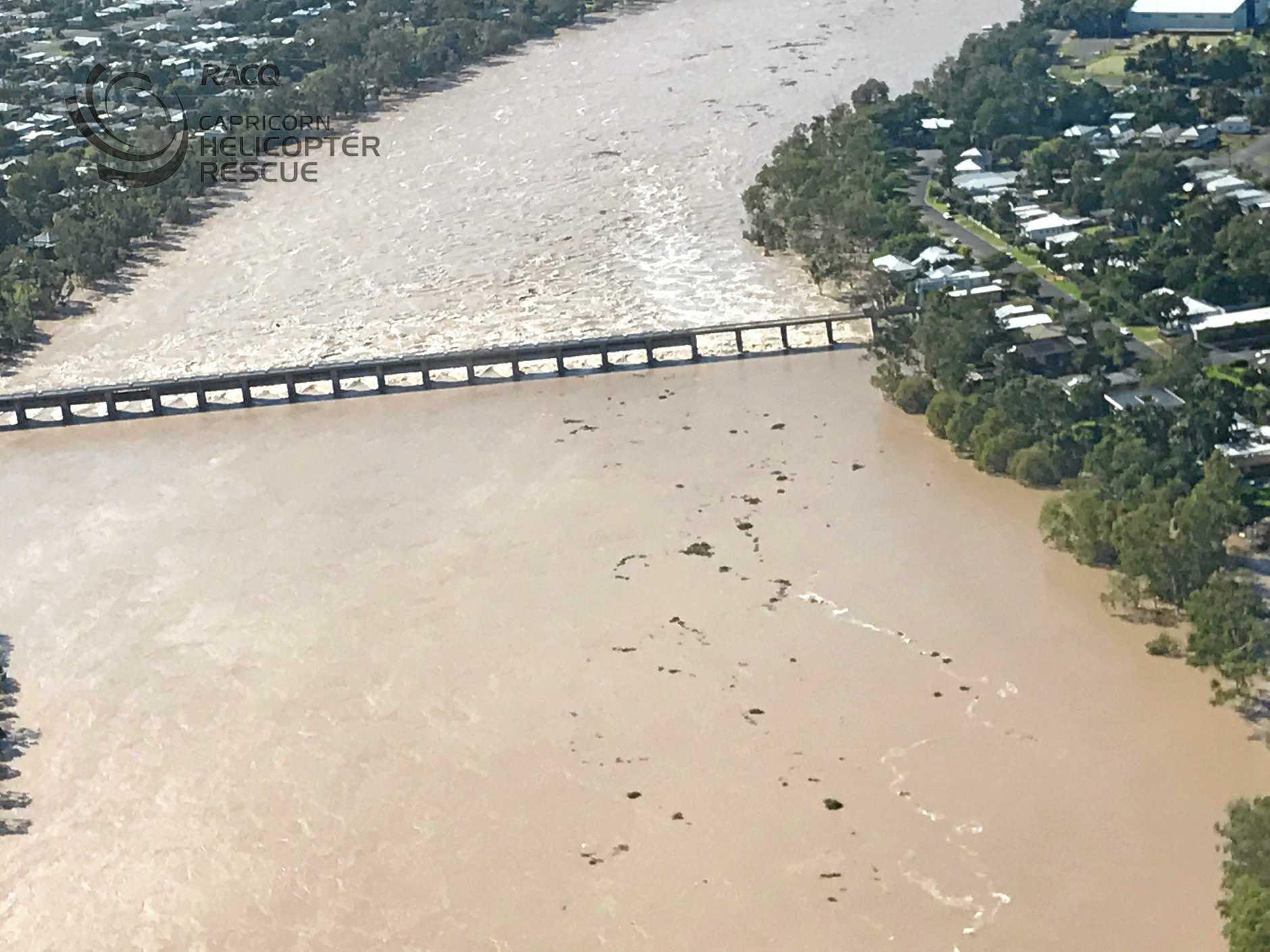 Flood water flows through the Fitzroy River Barrage into  Rockhampton on Tuesday, April 4.