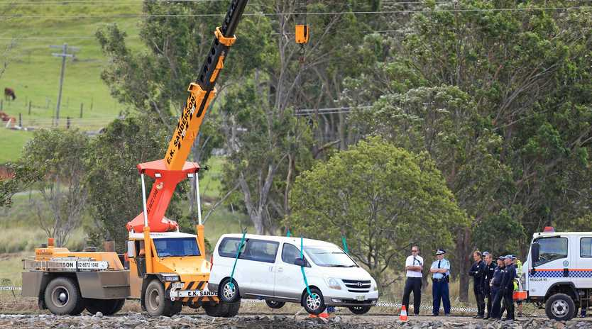 Police worked tirelessly to retrieve the bodies of a mother and her two children from their vehicle after it crashed into the Tweed River.