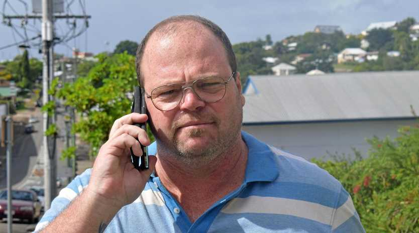 RECEPTION: Two Mile resident Ricky Ware achieves mobile reception after reporting neighbourhood mobile phone problems.