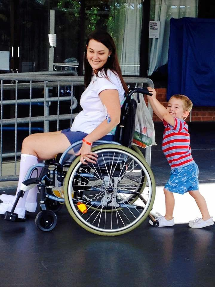 Jo Gilchrist and Tommy after a staph infection caused her to need a wheelchair to move around.