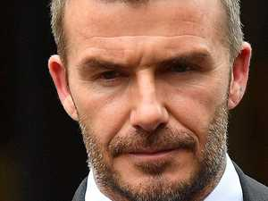 Beckham banned over phone fail