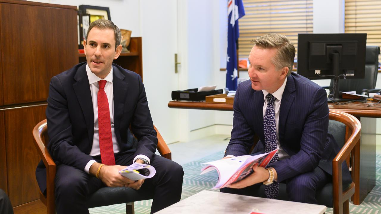 Shadow treasurer Chris Bowen (right) and Shadow Minister for Finance Jim Chalmers talk with the costings panel in Chris Bowen's office ahead. Picture: Rohan Thomson/AAP