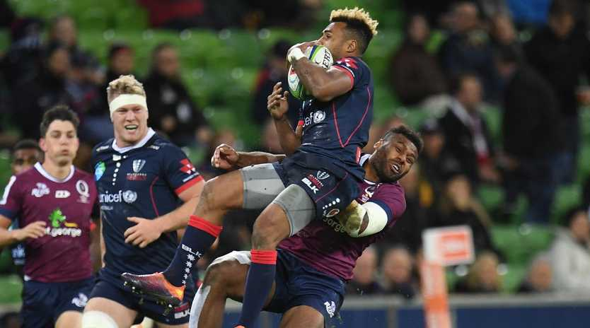Queensland's Samu Kerevi earned a yellow card for this challenge on Rebels halfback Will Genia. Picture: AAP