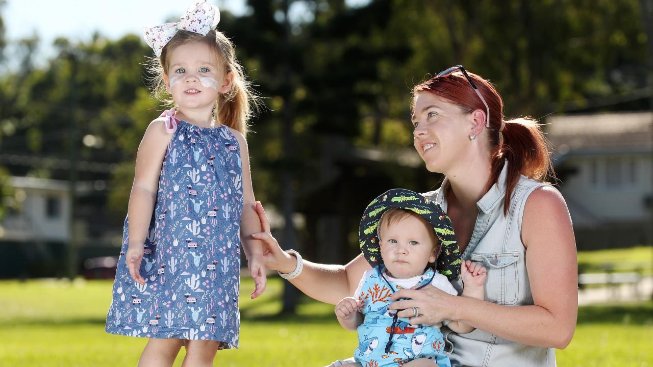 Jess Zambottie applying sunscreen with Charlotte, 2, and Henry, 9 months. Pics Tara Croser.