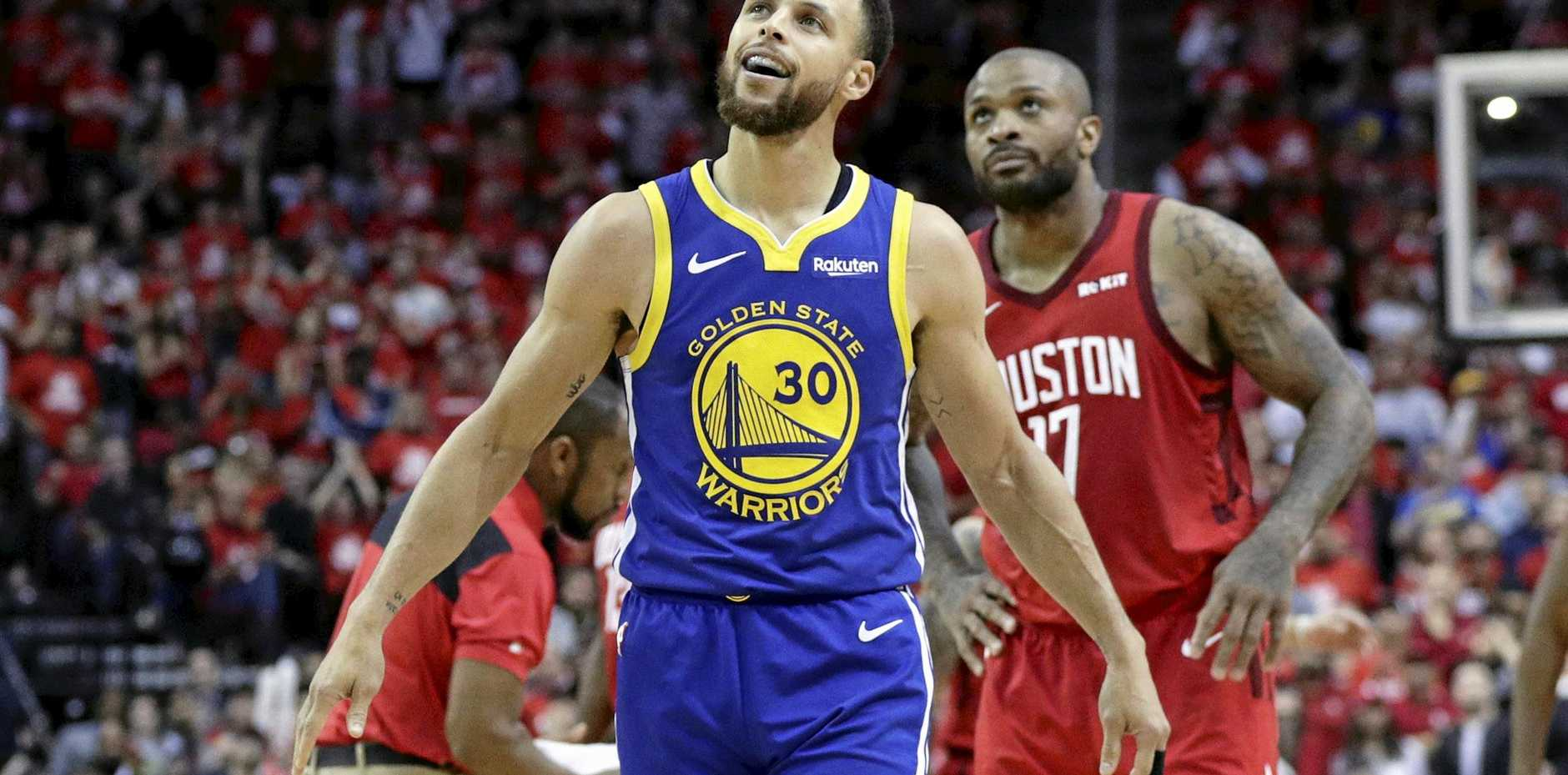 Golden State Warriors guard Stephen Curry looks pretty pleased with himself during the second half against the Houston Rockets. Picture: Eric Gay/AP