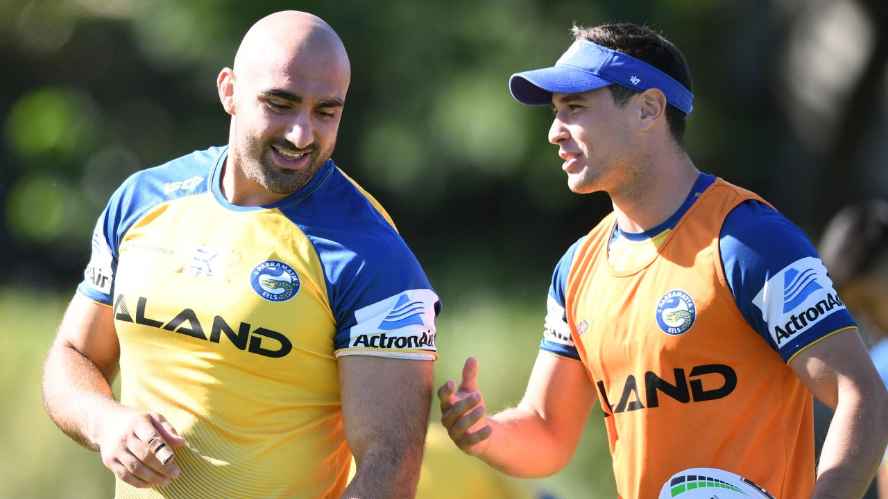 Tim Mannah and Mitchell Moses are much happier with the Eels playing some great footy. Picture: Joel Carrett