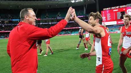 Dane Rampe celebrates Sydney's win with coach John Longmire. Picture: Phil Hillyard