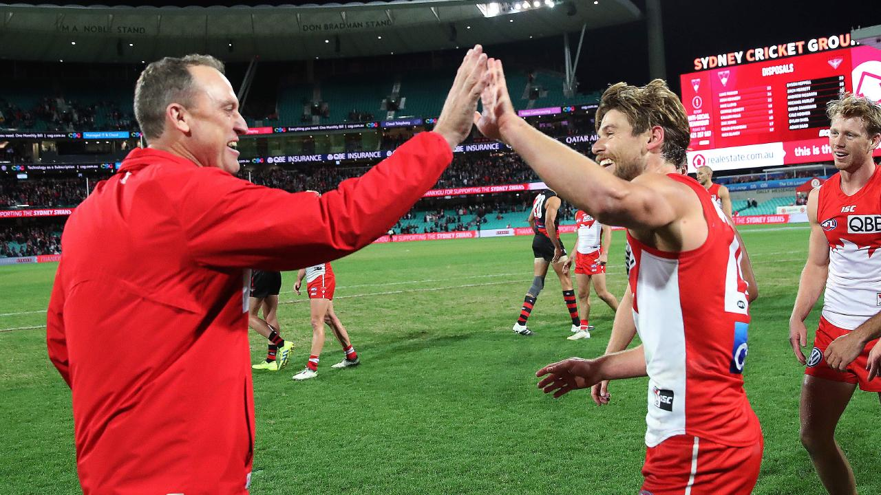 Dane Rampe celebrates Sydney's win with coach John Longmire. Picture: Phil Hillyard