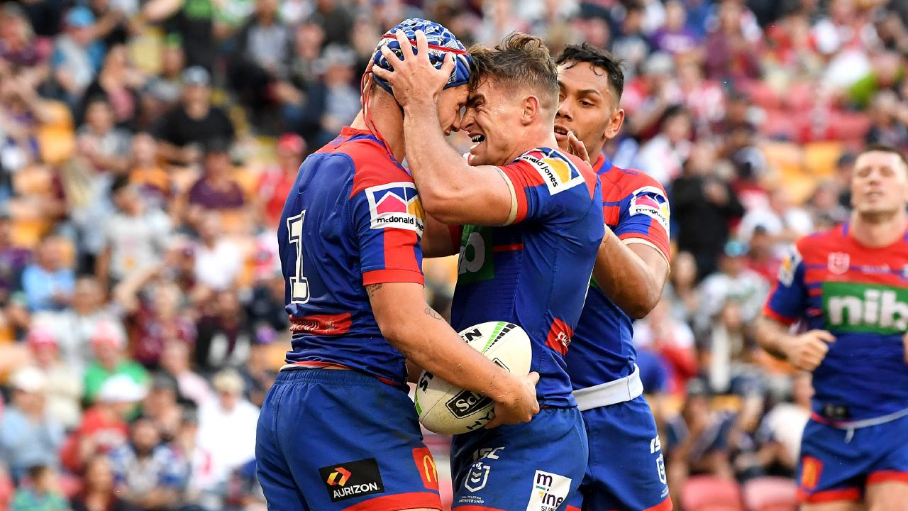Kalyn Ponga, left, sealed the victory with a late try. Picture: Bradley Kanaris/Getty Images