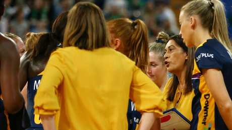Noeline Taurua (with clipboard, second from right) talks to her team during the 25-goal thrashing of West Coast last Sunday.