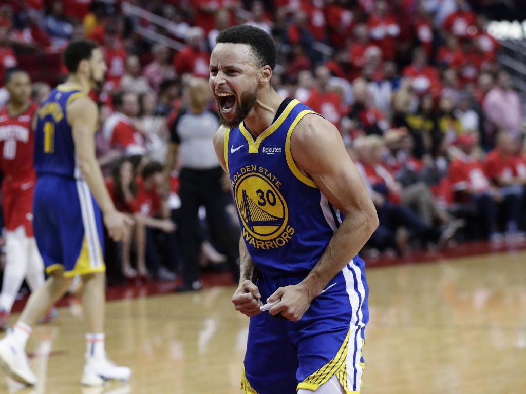 Steph Curry celebrates.