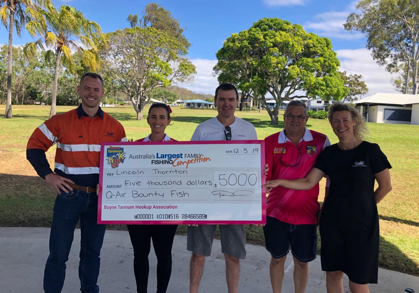 Lincoln Thornton (middle) is presented with a $5000 cheque for catching the Q-Air Port of Gladstone bounty fish. Pictured with him is Joshua Tindal and Karen Tindal from Q-Air and Rebecca Long and Andrew Davis from the Boyne Tannum HookUp at Bray Park.