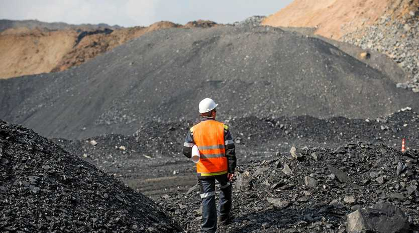 Coal mining in an open pit - Worker is looking on the huge open pit