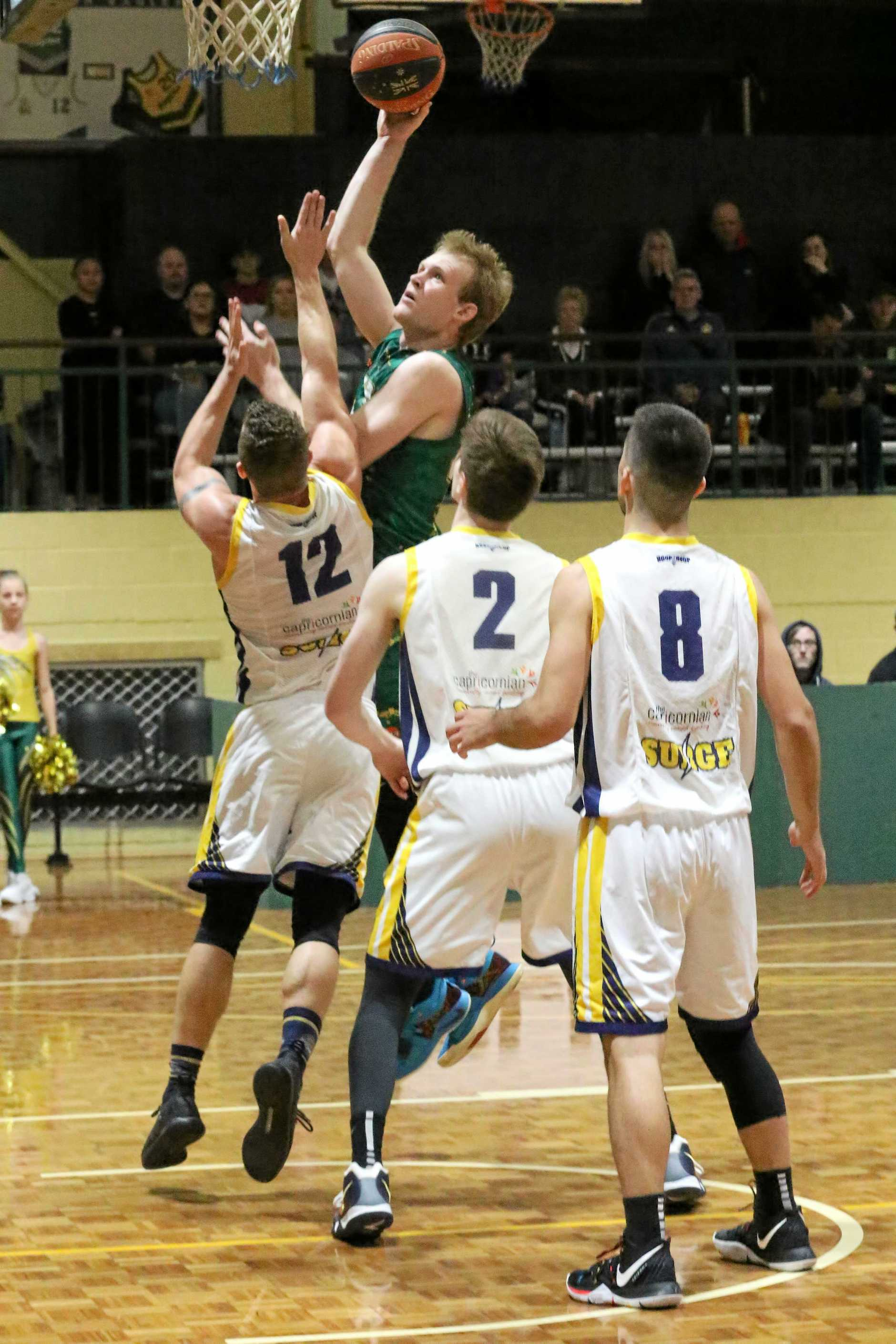 Ipswich Force basketballer Mitch Poulain takes charge in his team's QBL win over Gladstone.