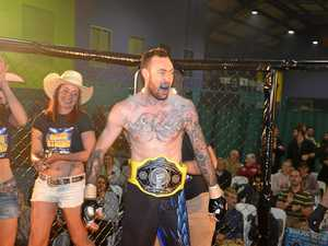 Champ cleans up at mixed martial arts, Warwick style