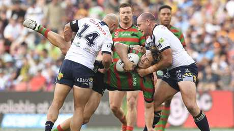 Cameron Murray gets caught up in the Cowboys tackle. Picture: Albert Perez/Getty Images