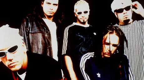 Lead singer Jonathan Davis with members of band