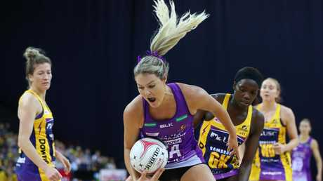 Gretel Tippett just keeps the ball in play for the Firebirds. Picture: Chris Hyde/Getty Images