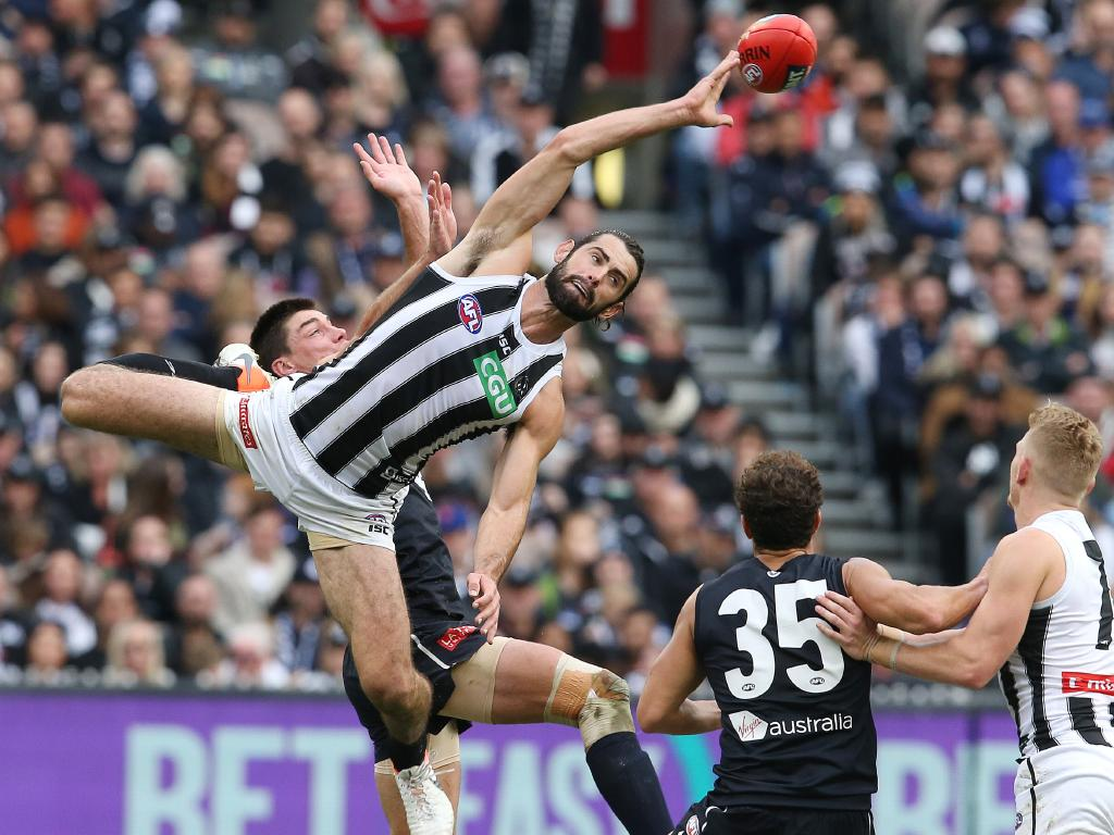 Brodie Grundy wins the centre bounce battle. Picture: Michael Klein.