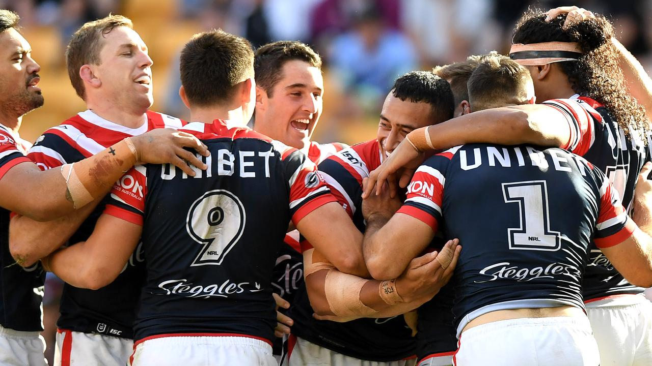 James Tedesco celebrates a try with his Roosters teammates at Suncorp Stadium. Picture: Getty Images