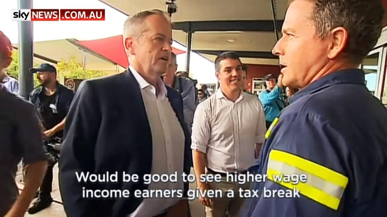 A Gladstone worker talks to Bill Shorten tax cuts for higher-income earners.