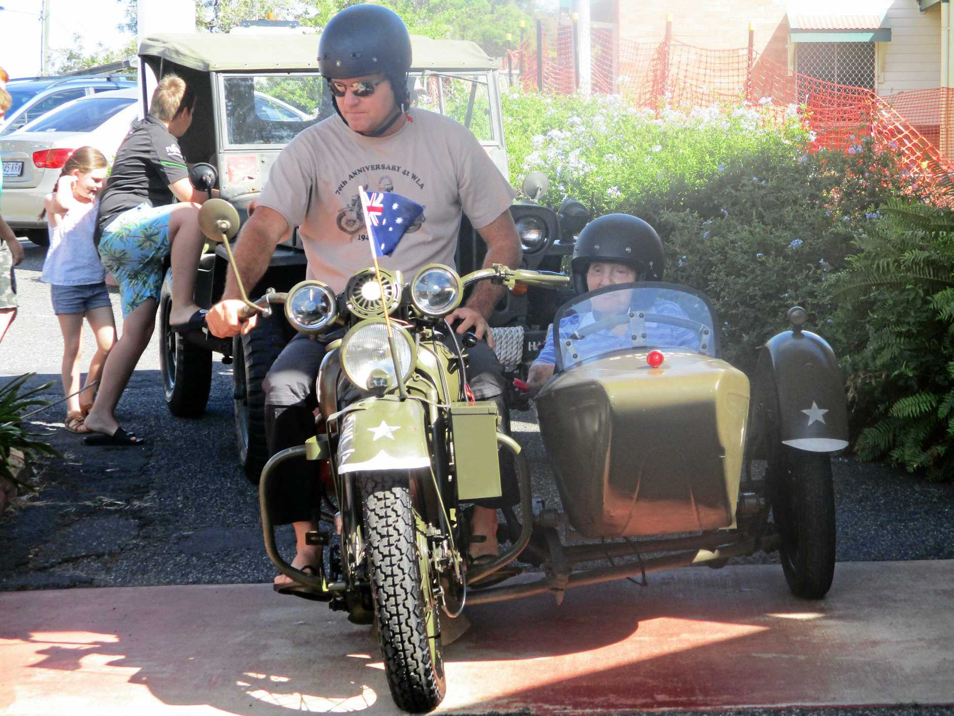 MOTOR'S RUNNING: Mount Morgan resident, Claude McKnight takes a ride in the sidecar of a World War II Harley Davidson army motorcycle as per his wish.