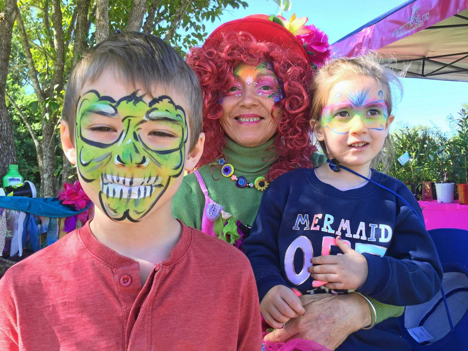 Elise and Edward Male of Bracken Ridge with face-painter Stacey.