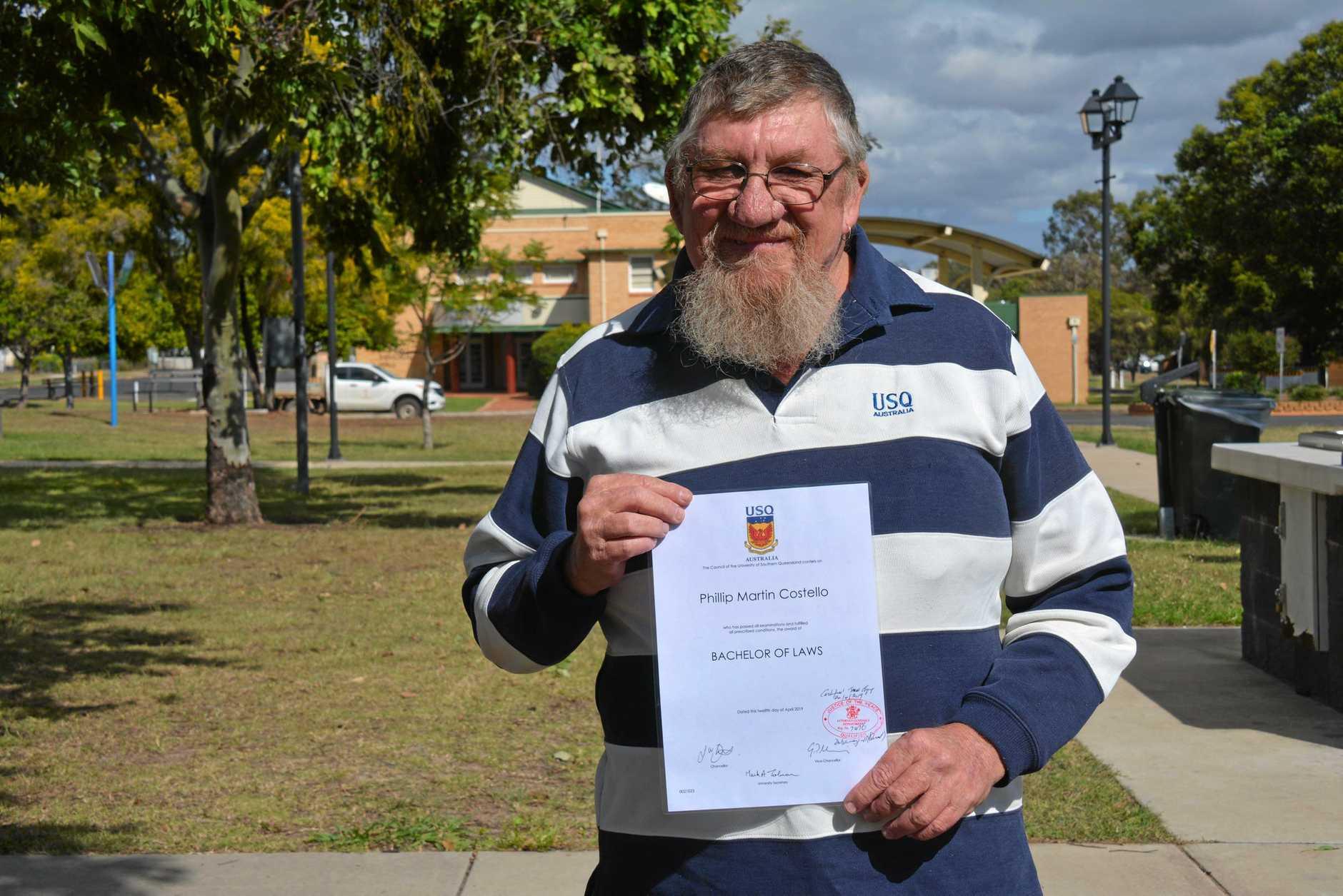 Local farmer Phillip Costello with his new law degree.