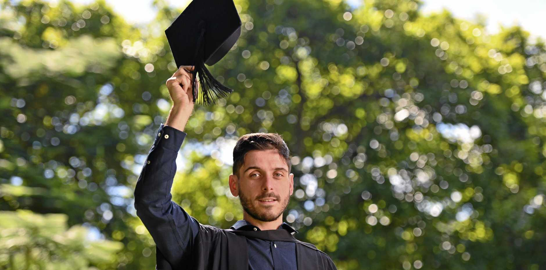 TOP MARKS: Ivan Reveruzzi graduates with a Bachelor of Education from USQ.
